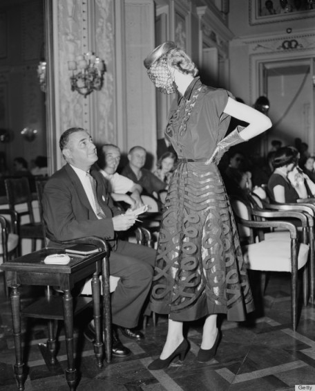 For Autumn/Winter 1951, it was stylish for models to interact with the buyers seated in the front row.