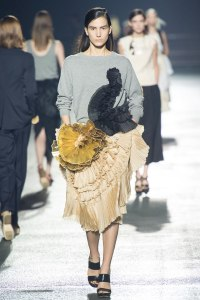 Sweatshirted and frilled at Dries Van Noten--and pleated gold to boot!