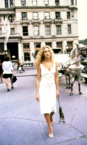 "Carrie Bradshaw outside The Plaza where she tells Mr Big of his new fiancé, ""Your girl is lovely, Hubble"" echoing Barbra Streisand's words in The Way We Were"