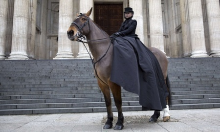 Lone horsewoman outside St Paul's Cathedral on day of Memorial service